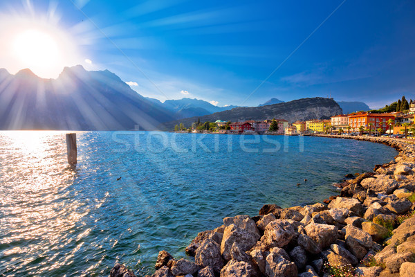 Colorful town of Torbole and Lago di Garda sunset view Stock photo © xbrchx