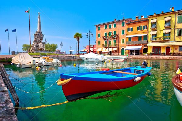 Lazise turquoise harbor and Lago di Garda view Stock photo © xbrchx