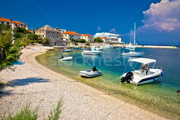 Beach and waterfront of Postira village Stock photo © xbrchx
