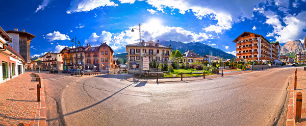 Cortina D' Ampezzo street and Alps peaks panoramic view Stock photo © xbrchx