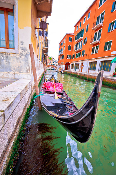 Gondola in narrow Venice channel view Stock photo © xbrchx