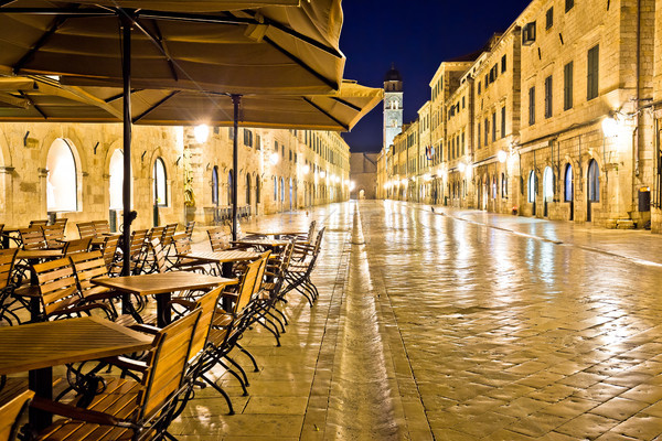 Famous Stradun street and cafe in Dubrovnik night view Stock photo © xbrchx