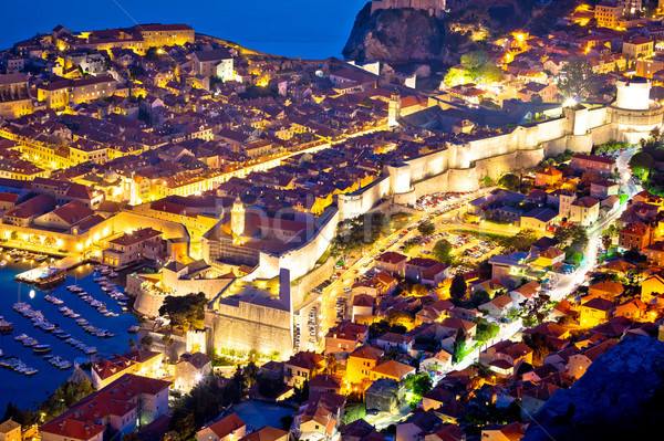 Historic town of Dubrovnik aerial evening walls and landmarks vi Stock photo © xbrchx