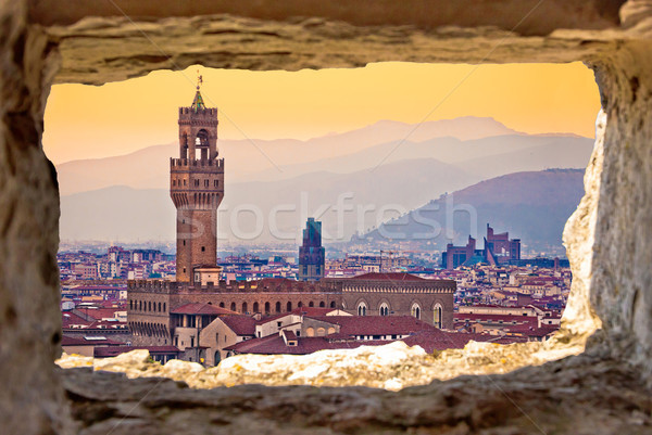 Ancient Florence cityscape and Palazzo Vecchio sunset view throu Stock photo © xbrchx