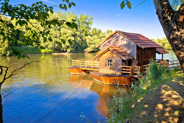 Old watermill on Mura river view Stock photo © xbrchx