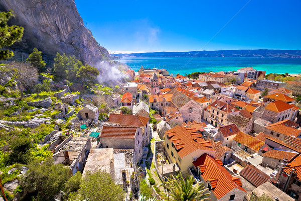 Town of Omis coast and rooftops panoramic view Stock photo © xbrchx