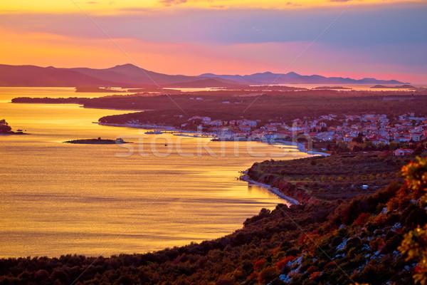 Adriatic town of Pakostane aerial sunset view Stock photo © xbrchx