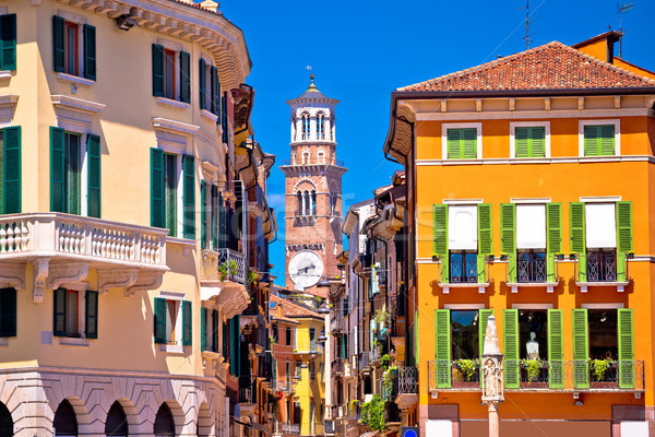 Verona colorful street and Lamberti tower view Stock photo © xbrchx