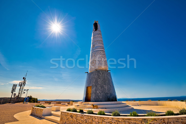 Giant Virgin Mary statue on hill above Primosten Stock photo © xbrchx