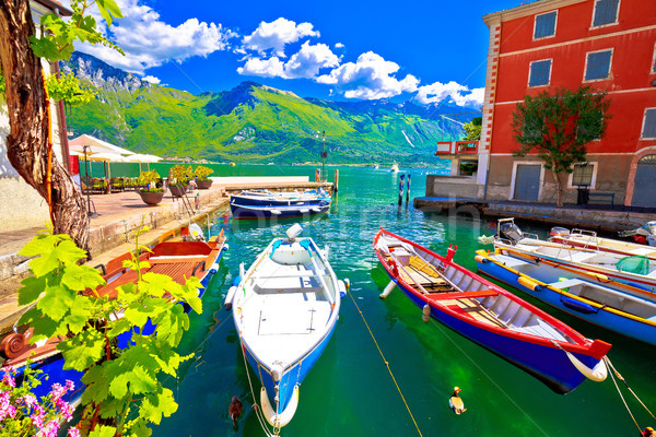 Limone sul Garda turquoise waterfront and boats view Stock photo © xbrchx