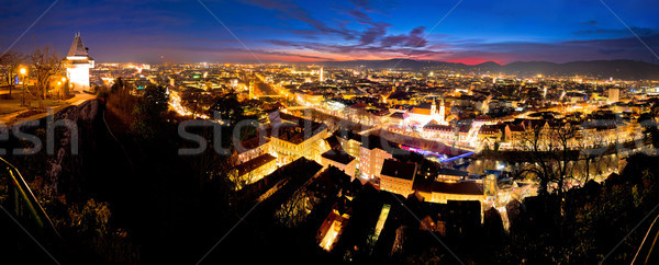 Graz aerial night panoramic view from Schlossberg Stock photo © xbrchx
