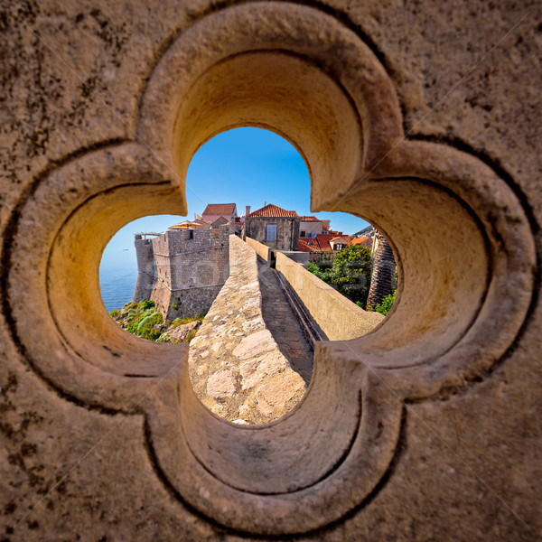 Dubrovnik city walls view through stone carved detail Stock photo © xbrchx