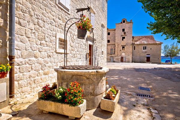 Dalmata kő építészet ősi kút régió Stock fotó © xbrchx