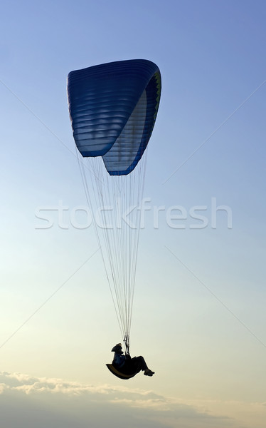 Stock photo: Paraglider in mid-air