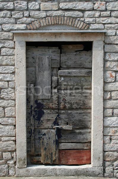 Alten Tür getragen Holz Stein Rahmen Stock foto © Ximinez