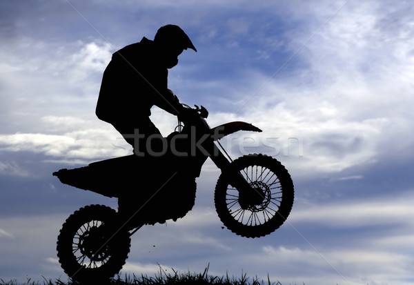 Motocross racer silhouette Stock photo © Ximinez