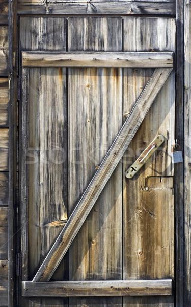 Fából készült ajtó vízpart kunyhó elszíneződött fenyőfa Stock fotó © Ximinez