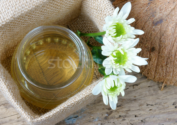 Stock photo: Coconut oil, essential oil, organic cosmetic