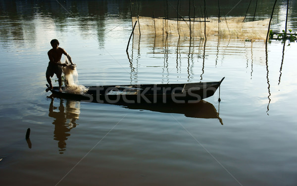 fisherman cast a net on river Stock photo © xuanhuongho