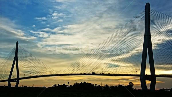 Pueden puente puesta de sol cielo agua ciudad Foto stock © xuanhuongho