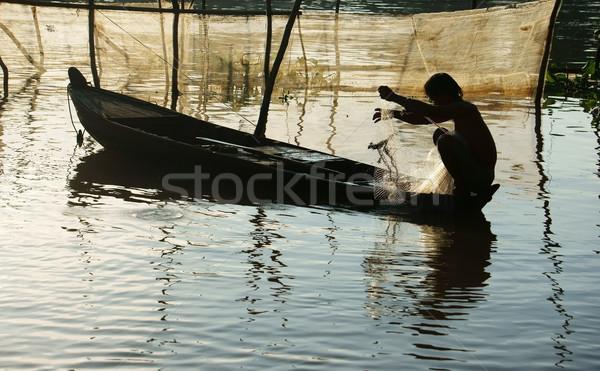 Visser vergadering rij boot omhoog net Stockfoto © xuanhuongho