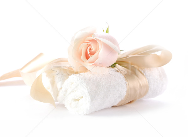 Rose with decorative ribbons over Rolled up Bath Towels Stock photo © xura