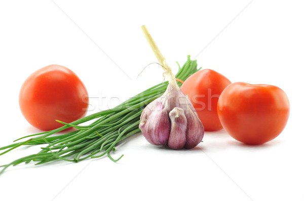 Mediterranean food ingredients: spring onions, garlic and tomato Stock photo © xura