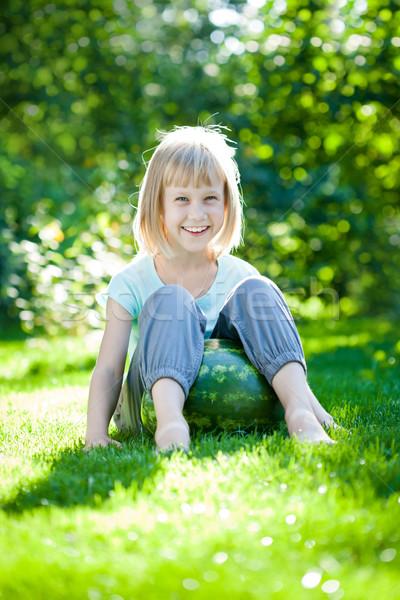 Child sitting on watermelon Stock photo © Yaruta