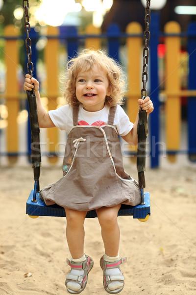 Dziecko huśtawka lata parku dziewczyna zabawy Zdjęcia stock © Yaruta