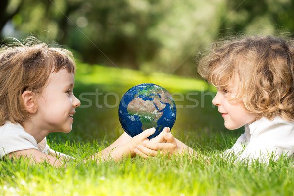 Earth in children`s hands Stock photo © Yaruta