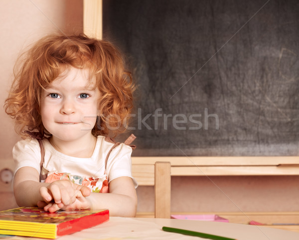 Schoolchild in a class Stock photo © Yaruta
