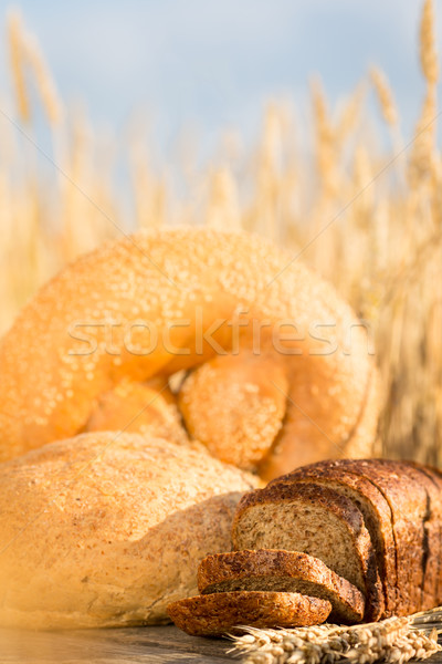 Homemade bread and wheat on the wooden table Stock photo © Yaruta