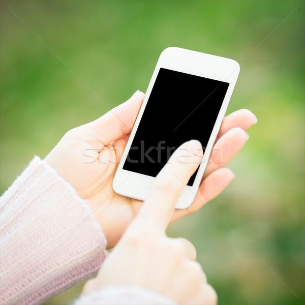 Smartphone donna mani verde primavera Foto d'archivio © Yaruta