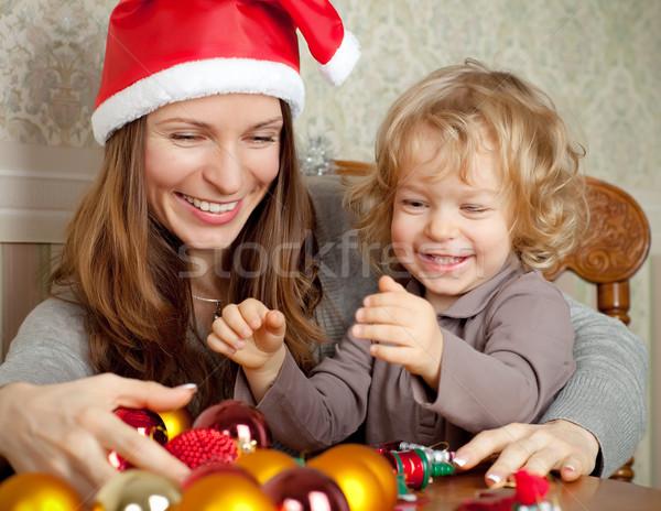 Szczęśliwą rodzinę christmas choinka dekoracje kobieta twarz Zdjęcia stock © Yaruta