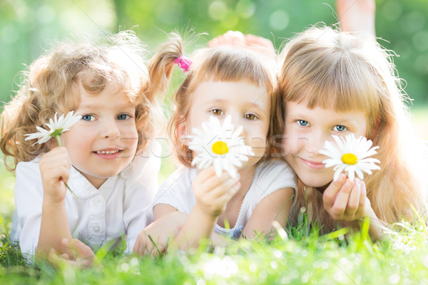 Children with flowers in park Stock photo © Yaruta
