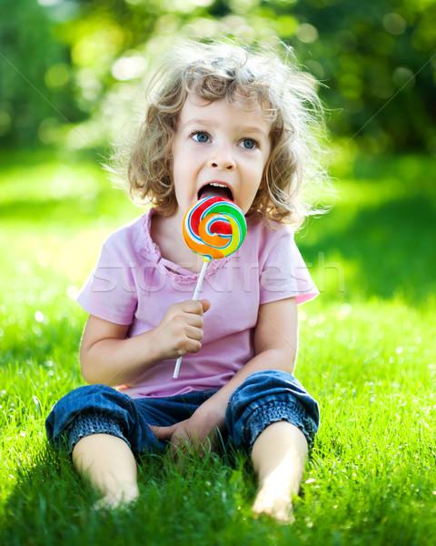 Foto stock: Criança · piquenique · feliz · alimentação · pirulito · grama · verde