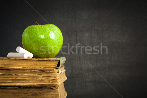 Green apple and chalk on old books Stock photo © Yaruta
