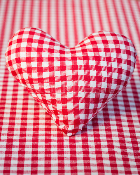 Red heart on gingham tablecloth Stock photo © Yaruta