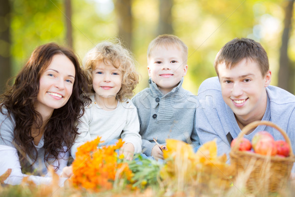 Happy family having picnic in autumn park Stock photo © Yaruta