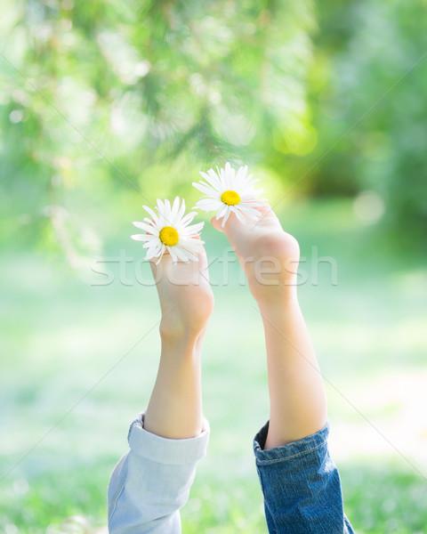Children`s feet with flowers Stock photo © Yaruta