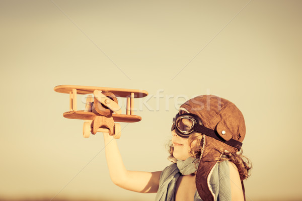 Happy kid playing with toy airplane Stock photo © Yaruta
