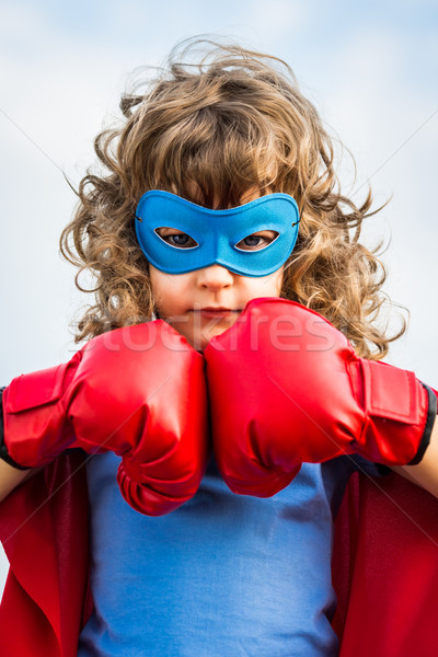 Stock photo: Superhero kid. Girl power concept
