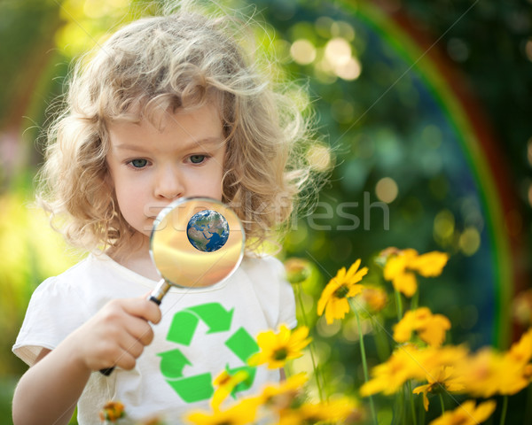 Child looking at spring flowers Stock photo © Yaruta