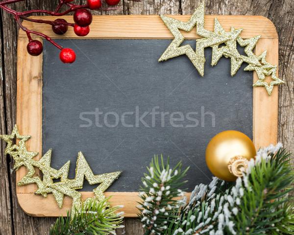 Vintage blackboard blank framed in Christmas tree branch and dec Stock photo © Yaruta