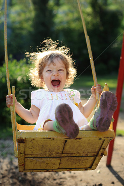 Child on swing Stock photo © Yaruta