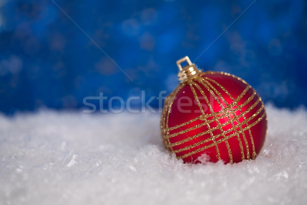 Christmas ball in snow Stock photo © Yaruta