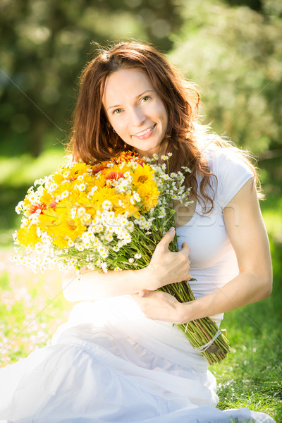 Woman holding bouquet of flowers Stock photo © Yaruta