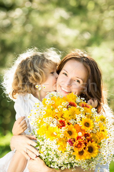 Woman and child with bouquet of flowers Stock photo © Yaruta