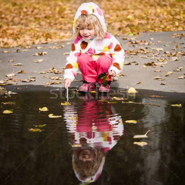 ребенка играет лужа счастливым осень парка Сток-фото © Yaruta
