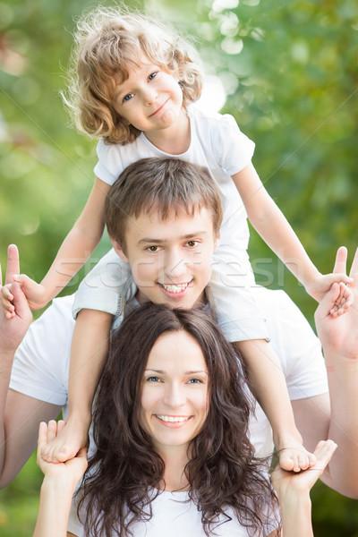 Boldog család jókedv kint tavasz zöld Stock fotó © Yaruta